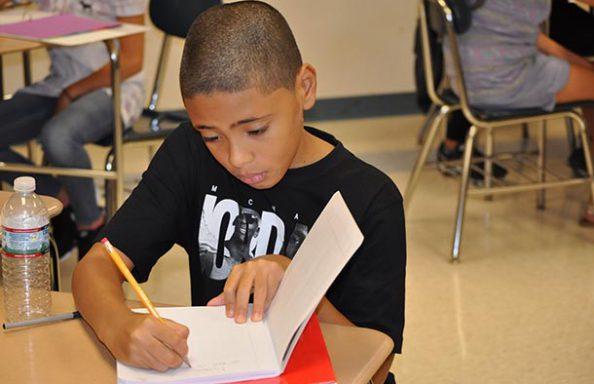 WGMS Boy in Class Writing