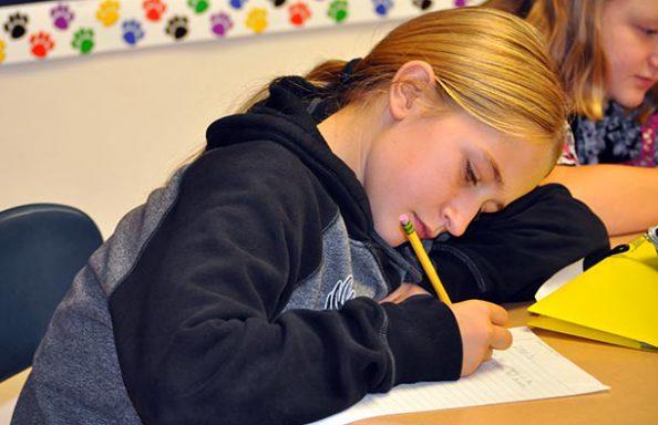 WGMS Girl in Class Writing