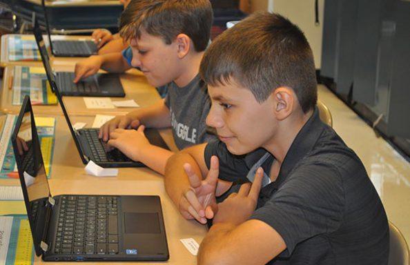 Split Rock Boy on Chromebook giving Peace sign