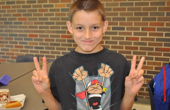 Split Rock Boy Giving Double Peace Sign