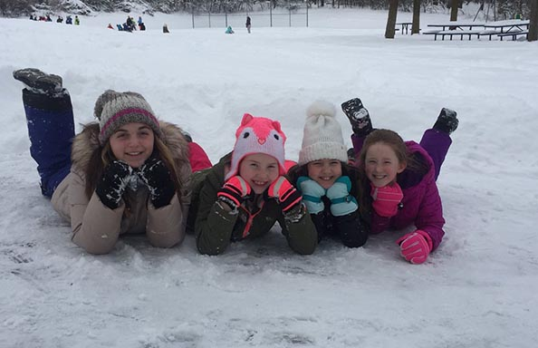 Split Rock Students Laying in the Snow