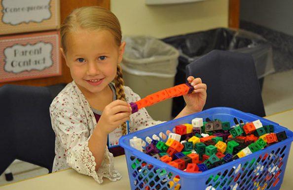 Onondaga Road Kindergarten Girl with Toy Blocks