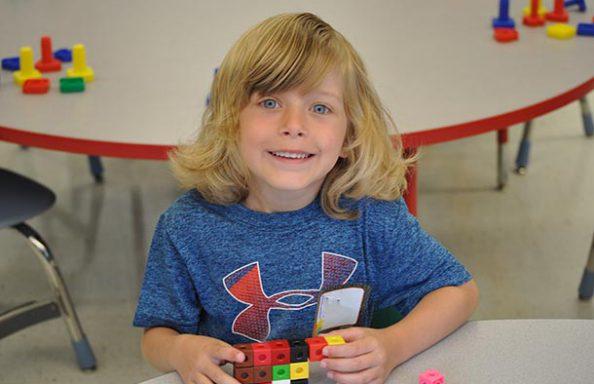 Onondaga Road Kindergarten Boy with Toy Blocks