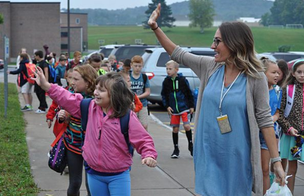 Stonehedge Teacher with Students Waving on First Day of School