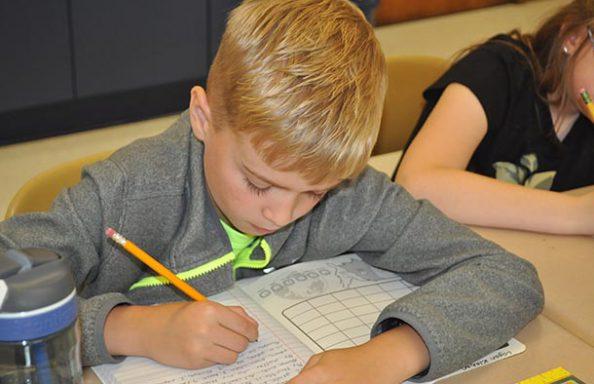 East Hill Boy writing