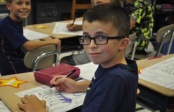 Split Rock Boy with Glasses Smirking