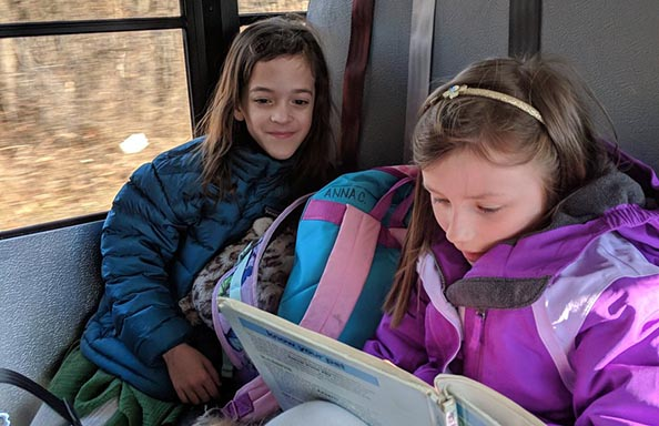 Split Rock Two Girls Reading on the Bus