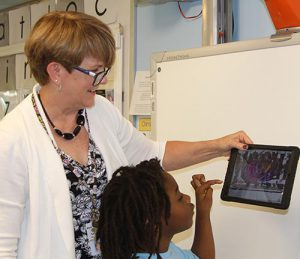 Barb Ritch helps Student with Technology