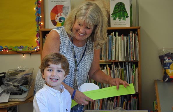 East Hill Boy with Staff Member on First Day of School