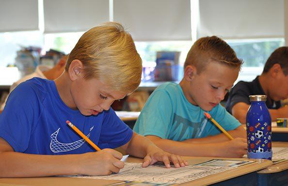Split Rock First Day of School Boys Working in Class