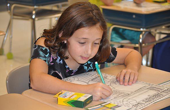 Split Rock First Day of School Girl Working in Class