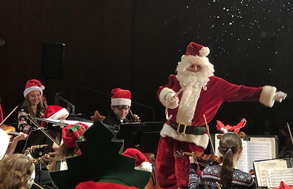 Holiday Concert Santa Conducting