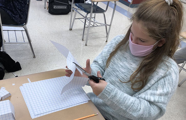 WGMS Girl cutting Graph Paper