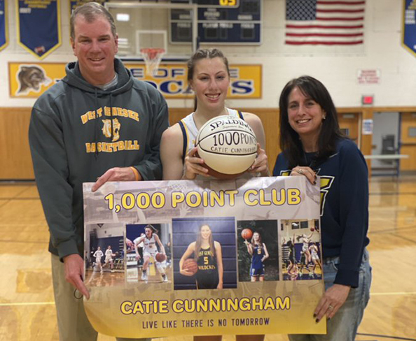 Catie Cunningham with Parents Scores 1000 Points